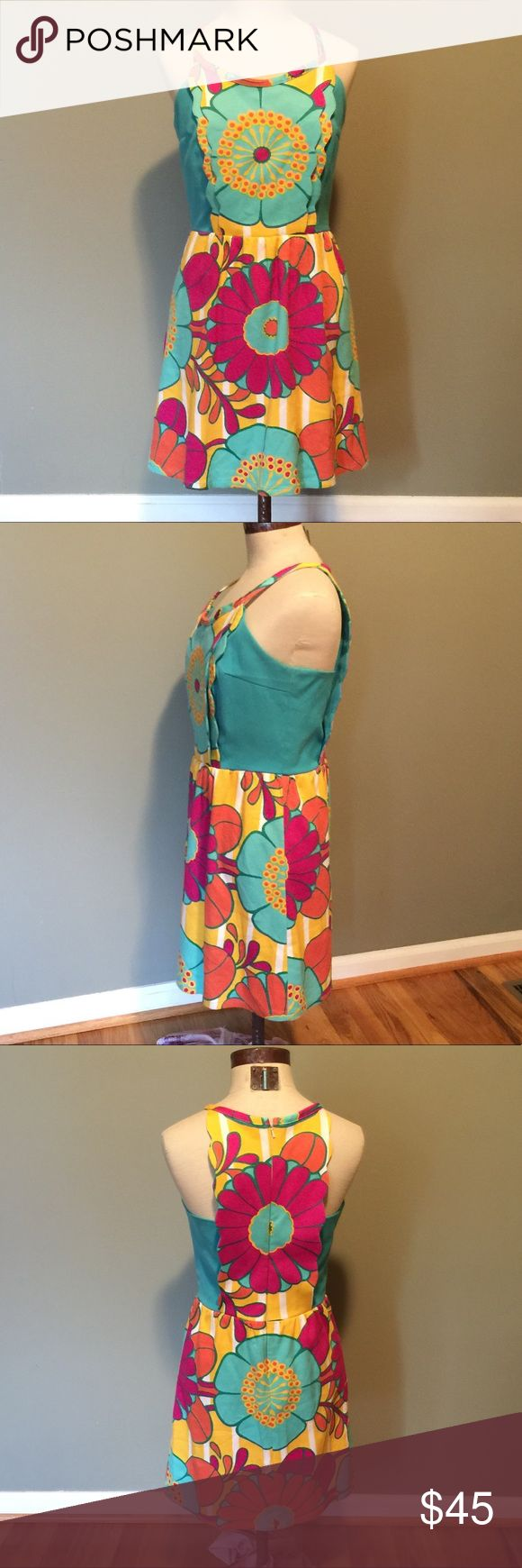 Anthropologie Judith March dress sz M floral Anthropologie Judith March apron style dress.  So unique, the fabric is a cotton polyester spandex pique in a colorful floral  print.  Size is medium.  I'm happy to answer any questions or post any pics as needed Judith March Dresses Midi