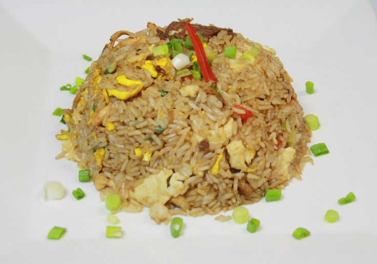 Arroz chaufa tres sabores: Chinese-Peruvian style fried rice cooked with a sensational mixture of chicken, beef and pork.