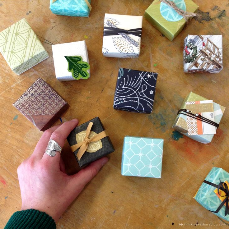 Learn to make tiny gift boxes out of last year's greeting cards