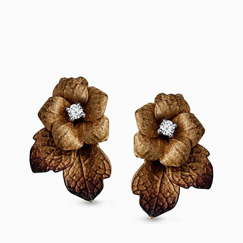 The arresting beauty of flowers was the inspiration for these unique earrings. T...