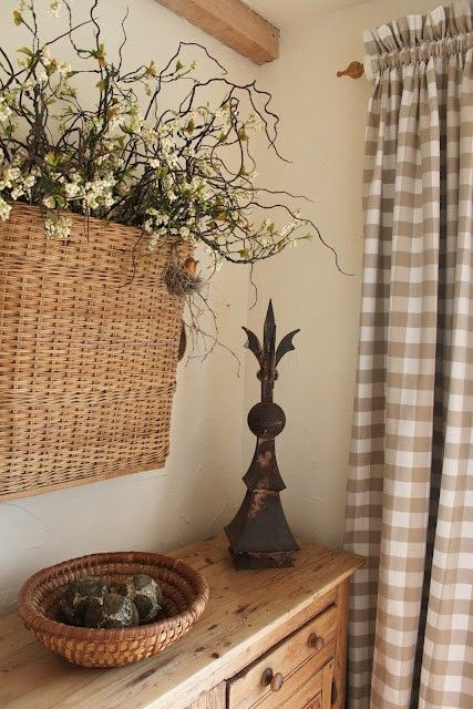 Refurbished wooden display table in corner of the dining room + Tan gingham full-length curtains