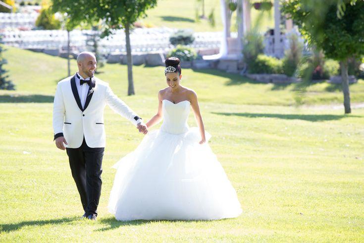 Royal Ambassador bride and groom walking