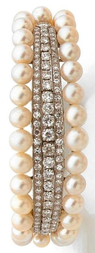 An ArtDeco cultured pearl, diamond, platinum and gold bangle, circa 1935. Set to the centre with three lines of brilliant-cut diamonds flanked on either side by a row of pearls in graduating sizes, mounted in 18k white gold and platinum. #ArtDeco #bangle