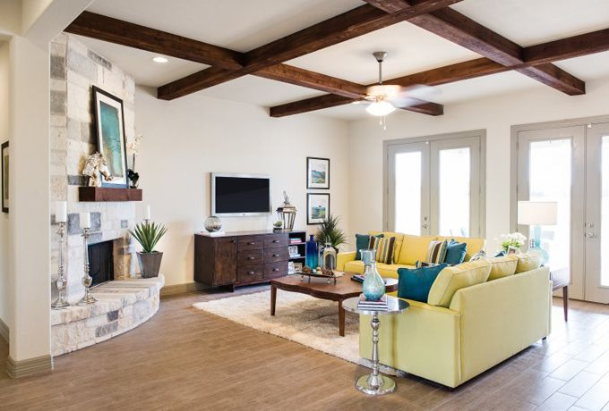 furniture placement with corner fireplace and TV.  two love seats House of Turquoise: Michelle Thomas Design