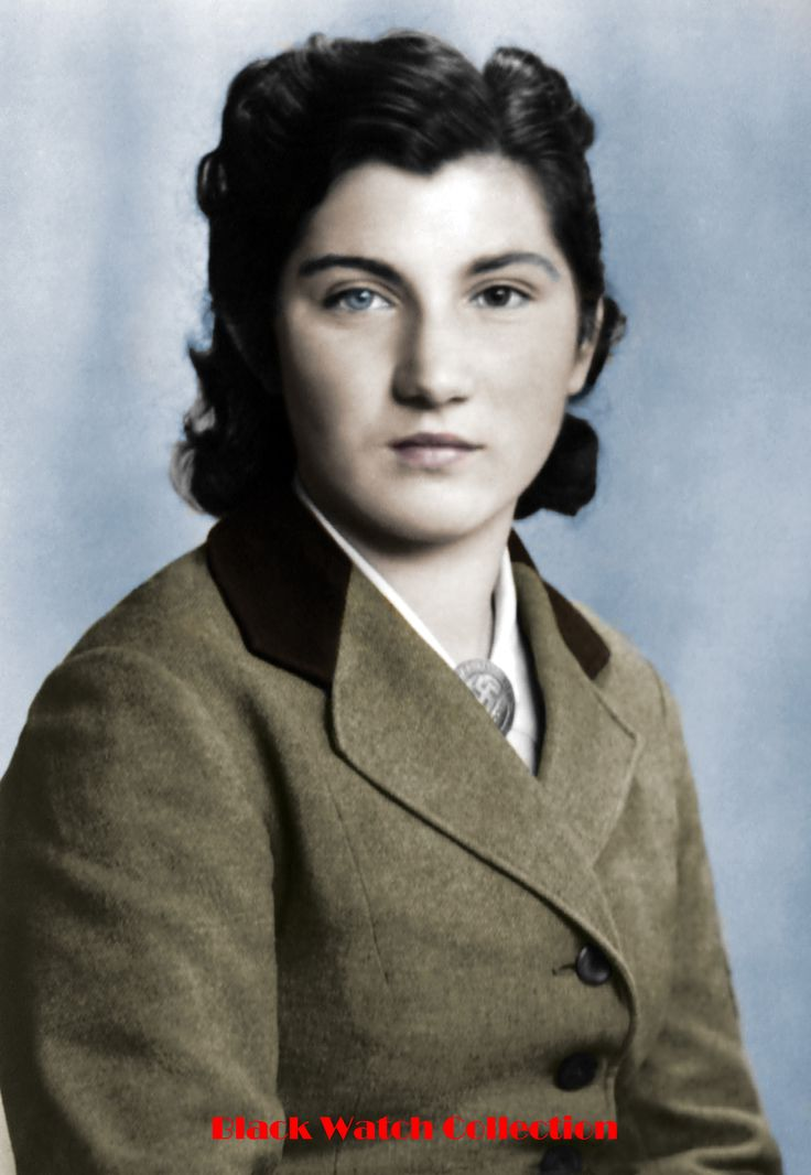 Member of the RADwJ in National Socialist Germany. She has Heterochromia which is essentially having either two different colored eyes or variations in the color in each eye. Circa WW2. From the photograph collection of Charles Meagher of Halifax, Nova Scotia.