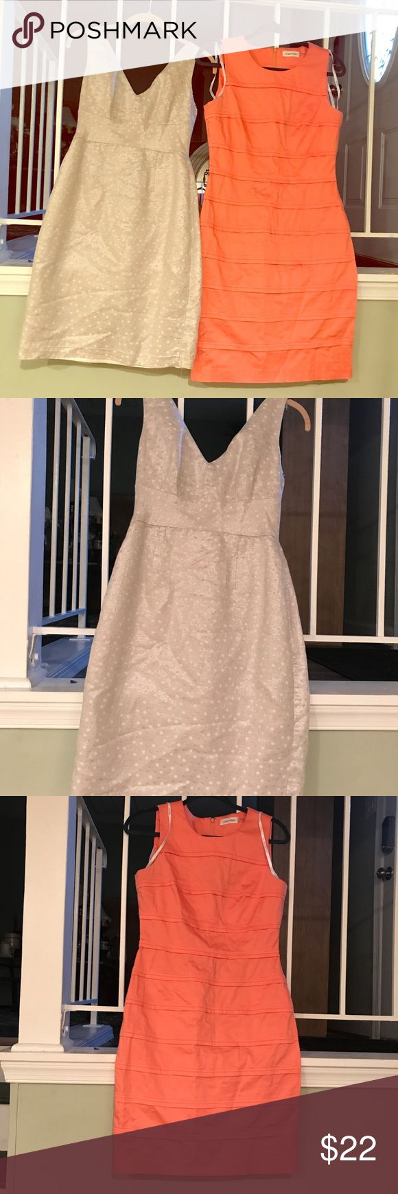 Calvin Klein dress Lot of two dresses; silver metallic jasper dress has the hem undone as shown in pics just needs to be restitched. Coral Calvin Klein dress has no defect. Both are great for the office or cocktails. Calvin Klein Dresses
