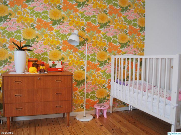 teak dresser + retro wallpaper in girl's nursery