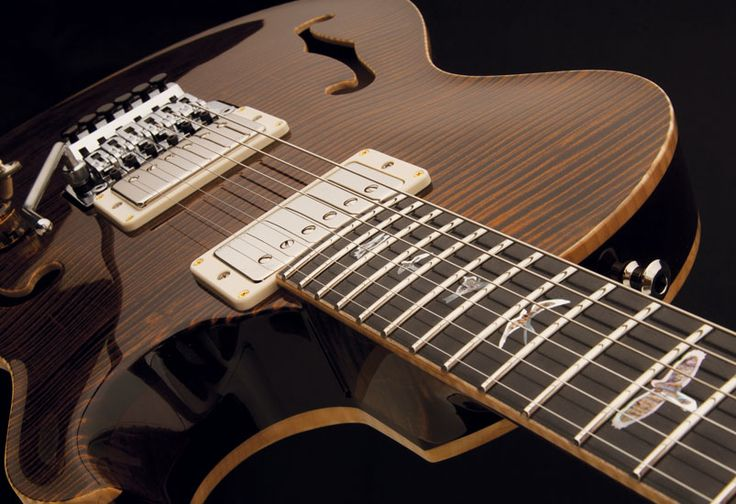 Super-exotic PRS Neal Schon limited run Guitar. Only 60 made.