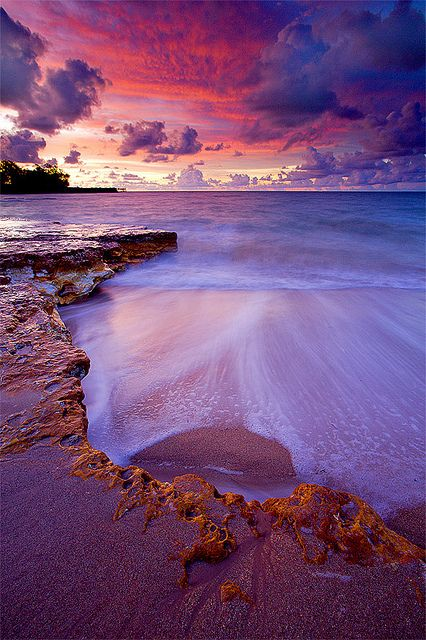 Nightcliff Beach lit up after sundown, Australia