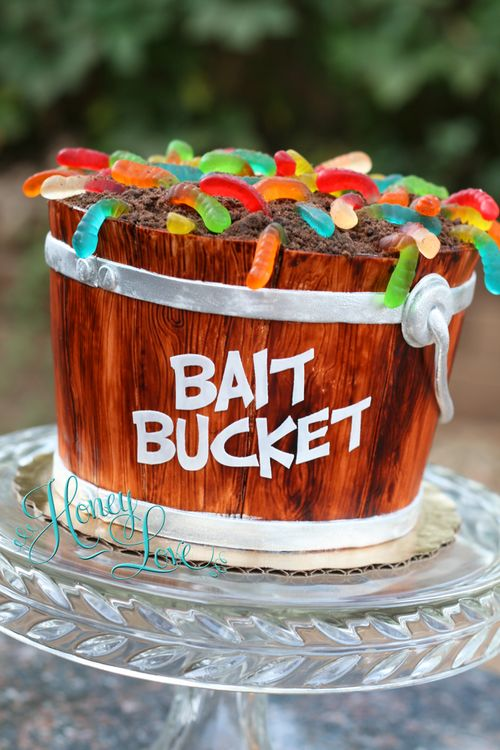 Bait bucket grooms cake with handpainted fondant wood details and gummy worms. Going fishing! Follow @HoneyLoveCakery on FB, Twitter, and Instagram.