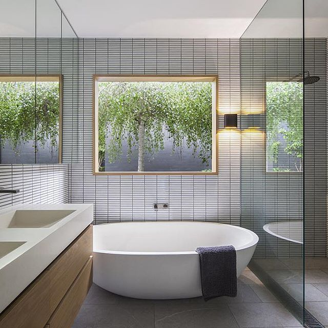 Bathroom shot from our recently completed and featured Reid St House. Walls of beautiful #inax tiles from @artedomus compliment pinch tapeware from @rogerseller. Floor tile from @stonetileind #melbournearchitecture #architecture #balwynarchitecture #interiors #bathroomdesign #inaxtile #rogerseller Built by @provanbuilt