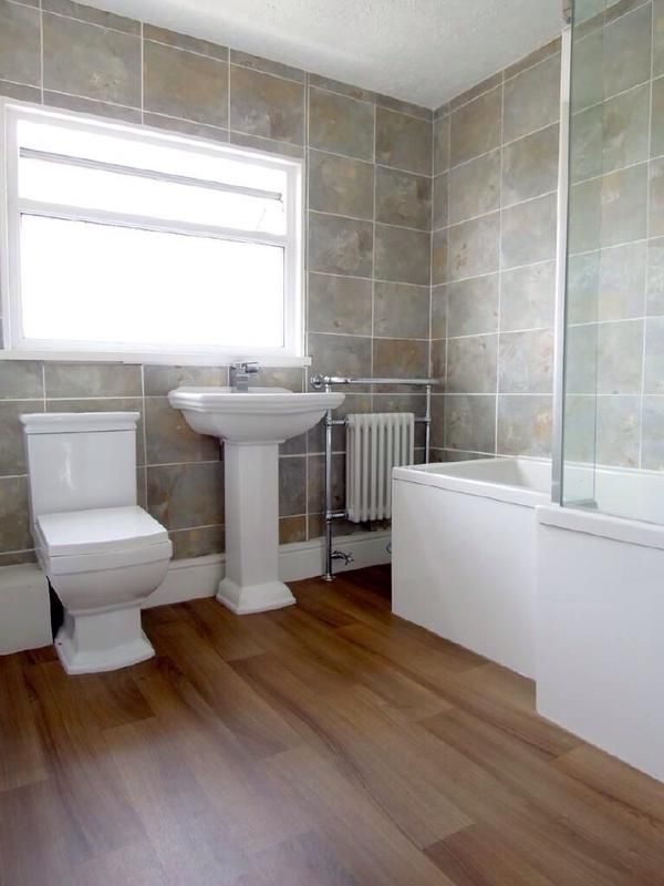 A beautiful bright and airy bathroom featuring a wood-effect floor, shower bath and striking toilet and basin from the Winchester range by VictoriaPlum.com. Thank you to Hannah from Plymouth for sending in this photo of her stunning bathroom.