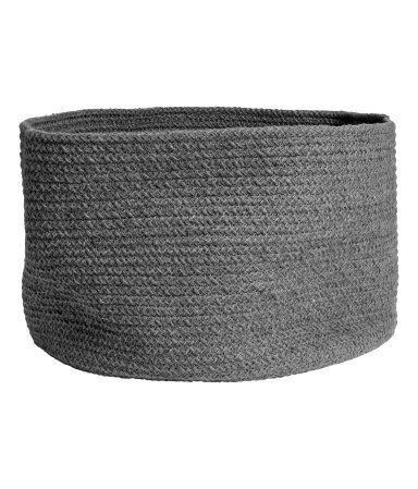Dark gray. Storage basket in thick melange cotton. Height 9 in., diameter 13 3/4 in.