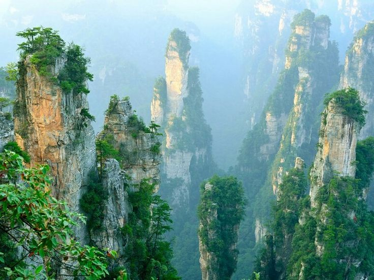 Wulingyuan Scenic Area, Zhangjiajie, China  Scenic might be an understatement: This100-square-mile attractioncontains thousands of sandstone pillars that are nature's version of skyscrapers—some even stretch taller than theEmpire State Building's midpoint. It's no wonder this site was a major inspiration for the world of Pandora inAvatar.
