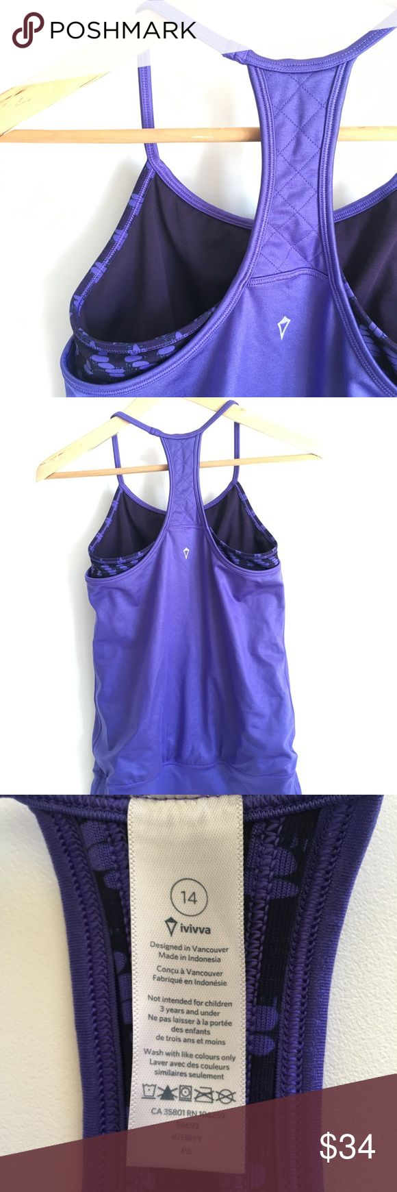 Ivivva Girls Purple Double-Dutch Tank Top Ivivva by lululemon double Dutch tank  Girls Sz 14  preowned ; Please refer to pictures. Double layer tank offers you coverage when you work hard at exceeding your athletic goals! Top layer in Mesh fabric is lightweight and sweat–wicking Added Lycra® fibre for serious stretch and long–term shape retention Tight–fitted body will move with you throughout the day COOLMAX® liner wicks sweat away from your body.  Racerback shape allows for full range of…