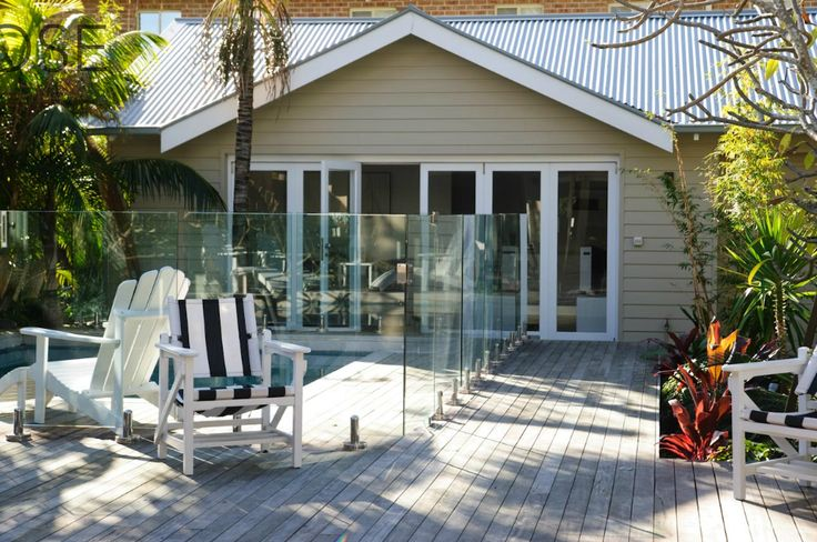 Grey colourbond roof, white trim, taupe weatherboard exterior - Driftwood Interiors
