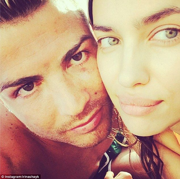 Posers: Cristiano Ronaldo (left) in a selfie with Russian model girlfriend Irina Shayk (right)