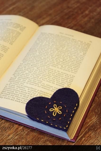Cute bookmark idea… two felt hearts sewn together. It won't fall out and you don't have to fold pages.