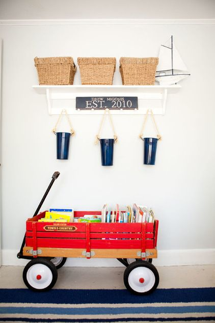 beach style kids by Tess Fine.  I love the idea of roll-able toy storage. In the article, laundry bins with wheels were another recommendation.