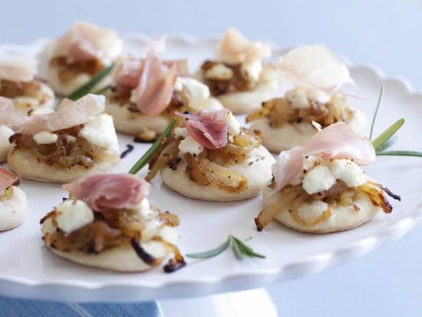 Pizzettes with Caramelized Onions, Goat Cheese, and Prosciutto. Holiday appetizer