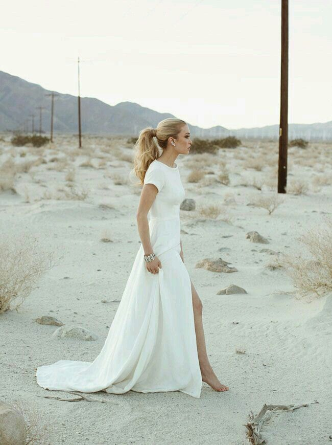 Simple And Understated Short Sleeve All White Modern Wedding Dress.
