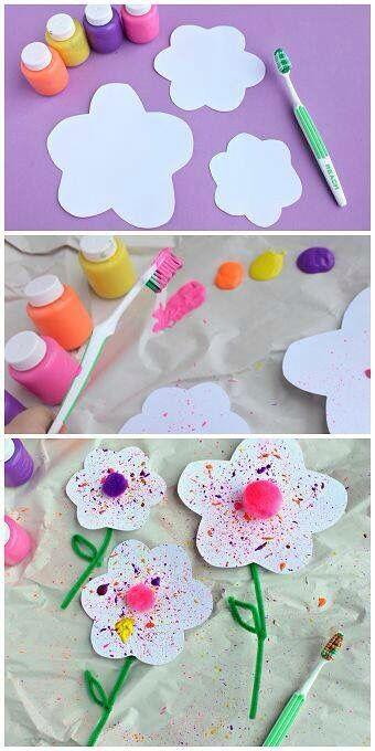 Lente bloemen maken door verf te spatten met een tandenborstel