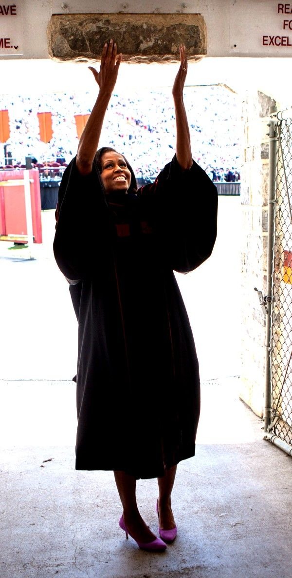 First Lady Michelle Obama touches the Hokie Stone before walking onto the field at Lane Stadium to give the Virginia Tech commencement address