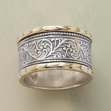 harmony ring    Nestled between 14kt gold castings, etched vines are a sterling expression of nature's harmony. Handmade.