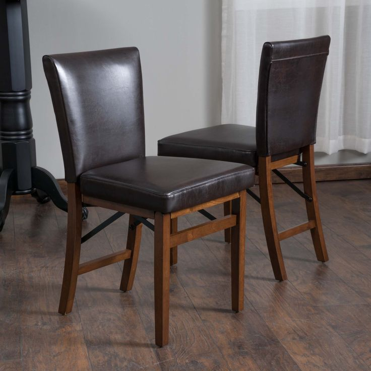 Rosalynn Brown Leather Folding Dining Chairs (Set of 2)  The Rosalynn Dining Chair is a perfect fit for any space in your home. Enjoy the contemporary shape adds an element of design to spruce up any dining room in a clean, yet sophisticated way. The folding features allows you to store them when not in use.  http://www.shareasale.com/m-pr.cfm?merchantID=69984&userID=1079412&productID=689114899
