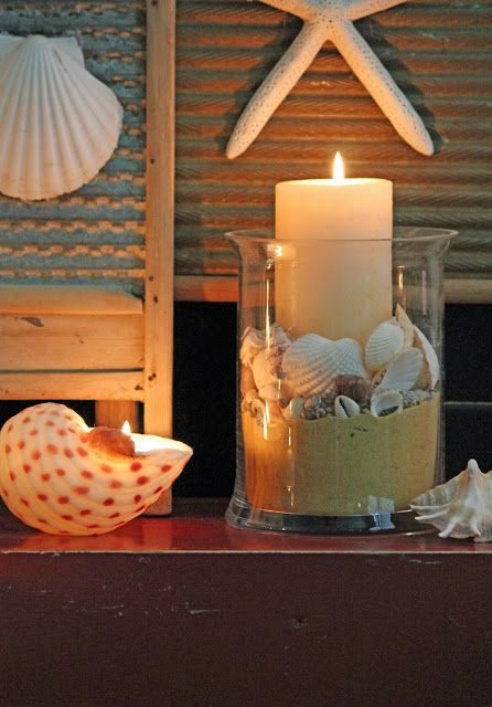 I have a candle like this where I put seashells I collected from a beach. I haven't thought of using sand