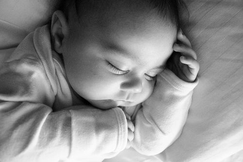 Putting baby down awake rarely works for newborns. How to put baby to sleep without rocking or nursing, so you and baby can get a break.