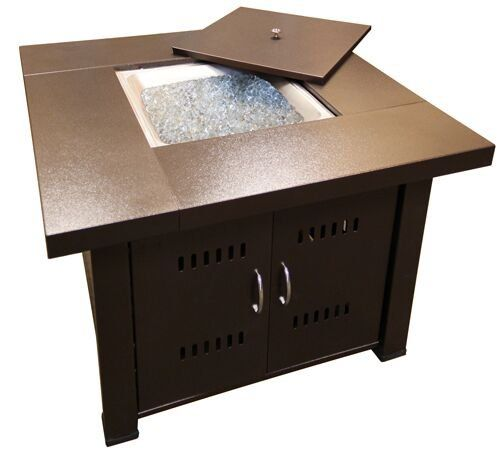 """Premium Quality Outdoor Fire Pit in Hammered Bronze  38"""" square tabletop, 28"""" tall  19"""" square lid, 17"""" square burn area  Gas type: Propane, butane  Heat output: 40,000 BTU's  Heating area: approx. 15 square feet"""