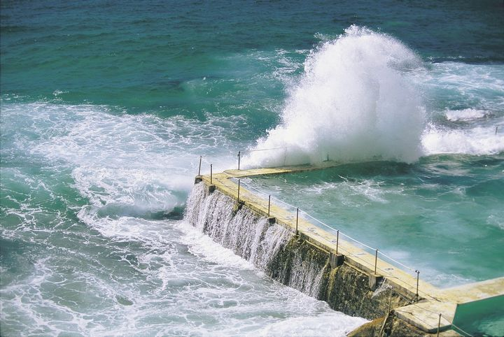 """Bondi Beach, Australia This was not always a public beach. It was private until 1982. Allegedly the name on Aborigine means """"water breaks over rocks"""". This beach is one of the best known surfing beaches in the world."""