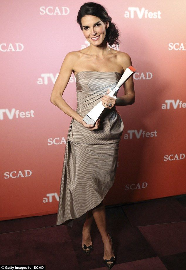 Earth tones: Angie Harmon slipped into a strapless taupe satin number to pick up an award at SCAD's aTVfest in Atlanta, Georgia on Friday
