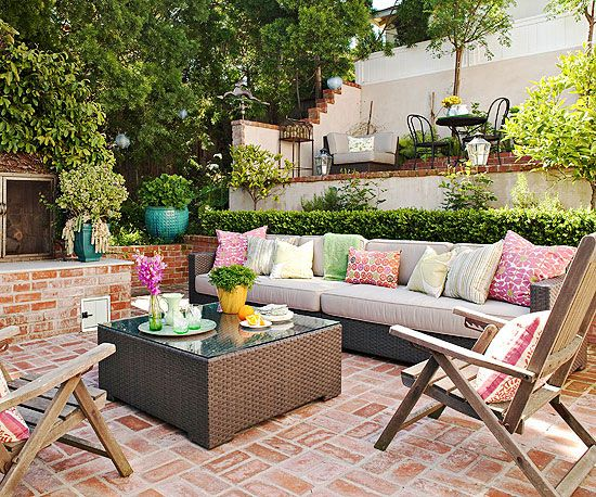 I love how cozy and layered this patio is. I wonder if you can achieve this effect if you have flat property.  It looks like low walls and planters in layers might work.