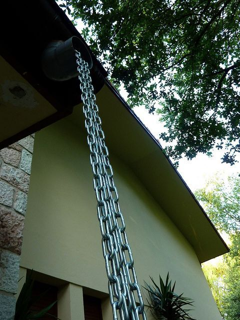 I have seen multiple ones hanging side-by-side and they look so pretty.....like a curtain.  Imagine it with the rain falling down them!    Rain chain by oriol4, via Flickr