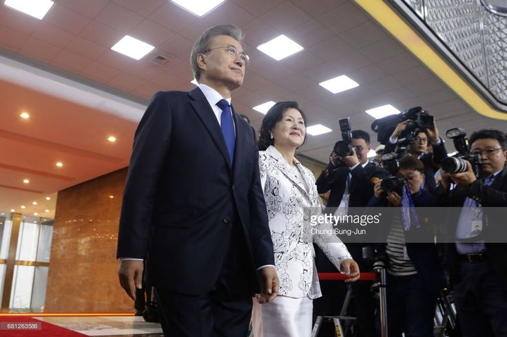 South Korea's new President Moon Jae-In and his wife Kim Jung-Suk arrive for presidential inauguration ceremony at National Assembly on May 10, 2017 in Seoul, South Korea. Moon Jae-in of Democratic Party, was elected as the new president of South Korea in the election held on May 9, 2017.