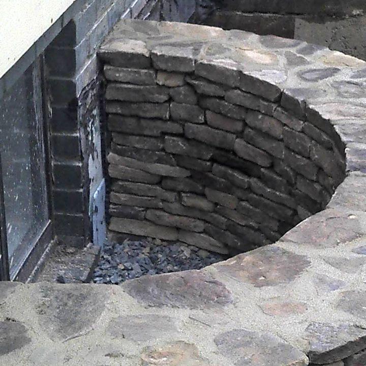 Stacked Stone Basement Window Well
