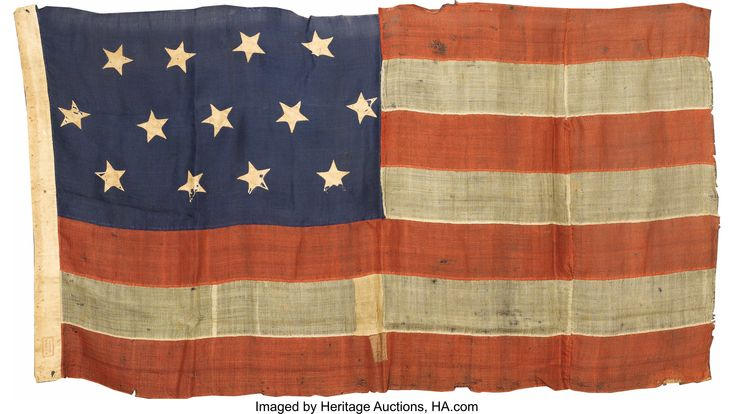 "13 Star U. S. Navy Boat flag, Circa 1863.   The  flag depicta 13 stars in a 4-5-4 configuration, made of wool bunting, 32"" x 58"" inches. This flag has only 7 stripes, which is unusual. The hoist has the flag maker's name: ""H. Korn, Philadelphia"".""  Heritage Auctions."