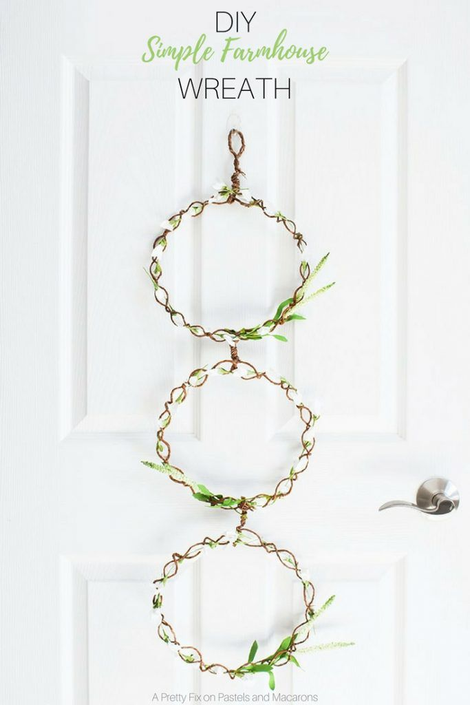 Learn to make a diy farmhouse door wreath that is simple and elegant.