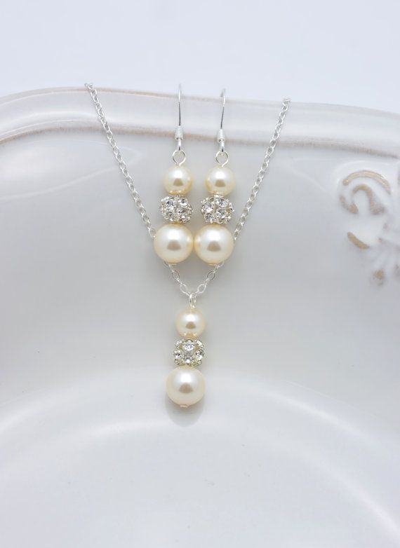 Hey, I found this really awesome Etsy listing at https://www.etsy.com/listing/166023729/ivory-pearl-and-rhinestone-necklace-and