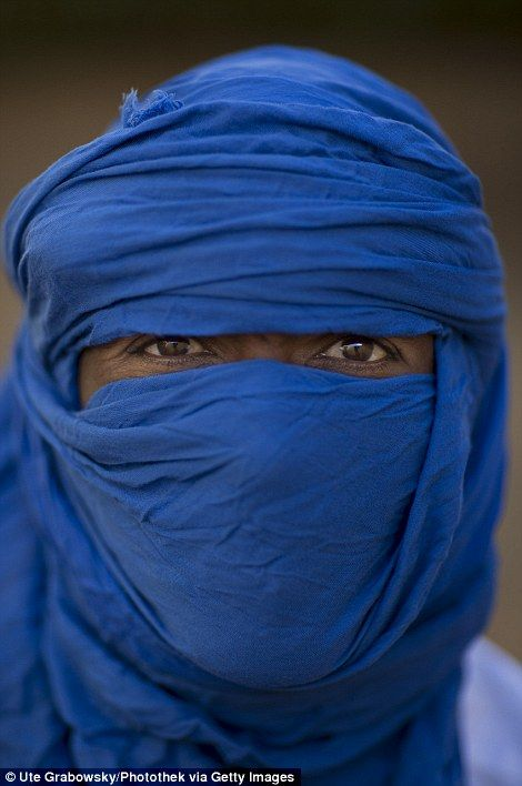 A Tuareg man wearing a blue turban in Niamey, Niger...