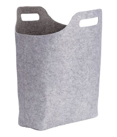 Gray. Large storage basket in thick, felted fabric with two handles at top. Size 6 x 14 1/4 x 15 in.