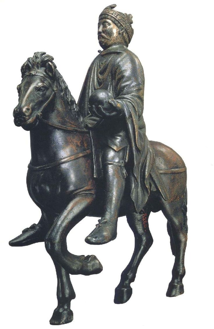 [Unknown,Equestrian portrait of Charlemagne or Charles the Bald, Ninth century,Bronze, from Metz, France,Carolingian Art]This equestrian portrait shows a Carolingian emperor on horseback.He is wearing imperial robes,holding a globe on his outstretched left hand. This symbolizes world domination and Roman Empire's power.His crown, large eyes, frankish mustache, gartered leggings and visible sheathed sword are notable details of the equestrain too.(Kleiner 416 and Oxford Art Online)