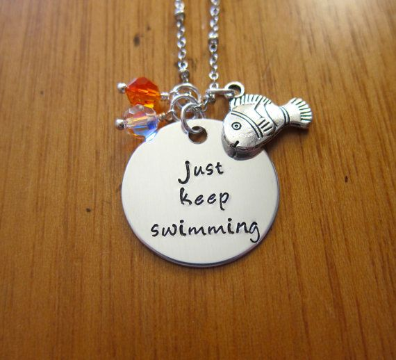 "Disney's Finding Nemo Inspired Necklace. Dory quote ""just keep swimming"" by WithLoveFromOC, $21.00 & free shipping. Swarovski Crystals and a Clown fish charm."