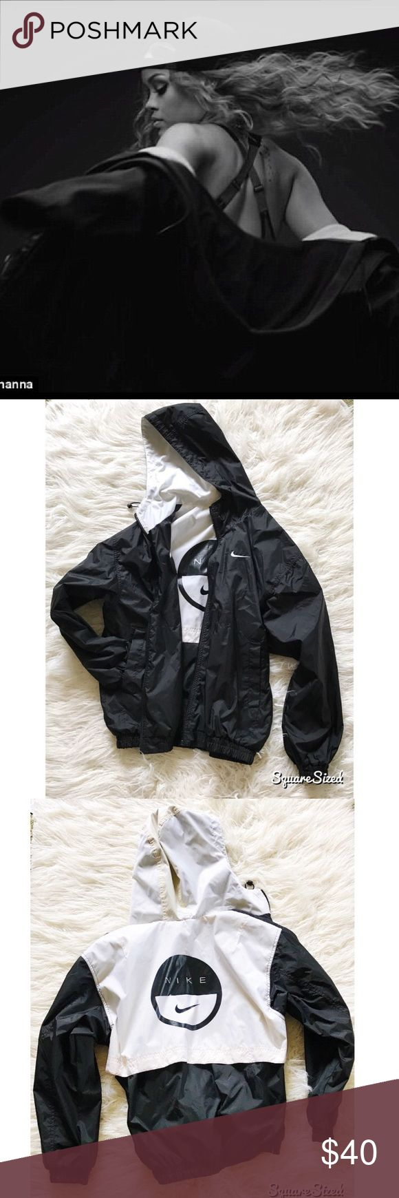 Old School Nike Windbreaker Jacket You can wear this reversible vtg 90's windbreaker all black or flip it inside out and have a color-block black and white look.  featuring embroidered Nike long on both sides, pockets and adjustable hood. Slight discoloration, small pen marks on the white hood but in otherwise excellent condition. Labeled size M but I like to wear mine oversized. Bring back the retro Hip-Hop street fashion with this 90's Nike windbreaker. Athletic wear or pair with high…