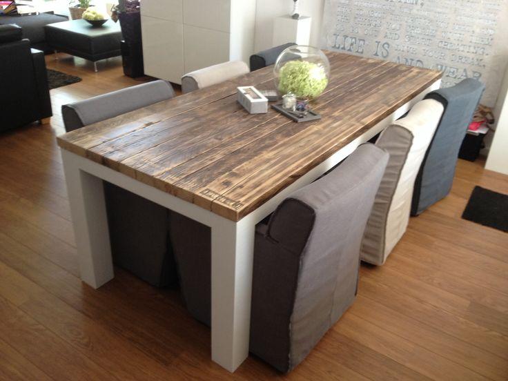 Diningtable with 2 inch thick reclaimed wooden tabletop.