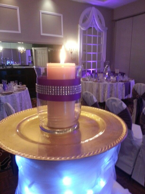 Dollar store plate vase and candle wrapped in purple