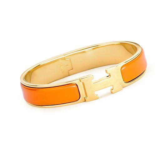 "Clic H Hermes narrow bracelet Orange enamel Gold plated hardware, 2.25"" diameter, 7.5"" circumference, 0.5"" wide"