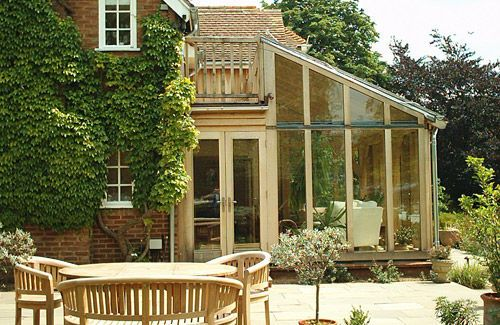 Oak frame conservatory with hidden balcony